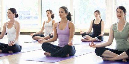 Women practicing yoga in a class