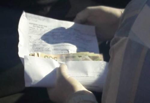 На Черкащині поліцейські погоріли на хабарі у розмірі однієї тисячі доларів
